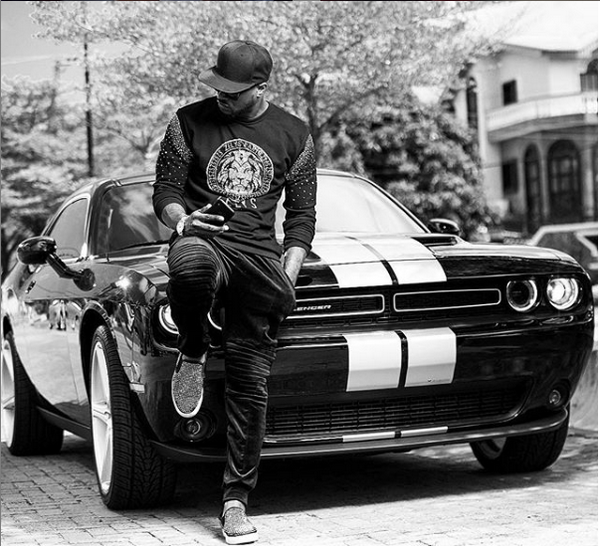 Peter Square posing beside his Mustang