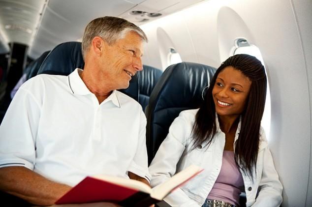 two-people-talking-in-a-plane