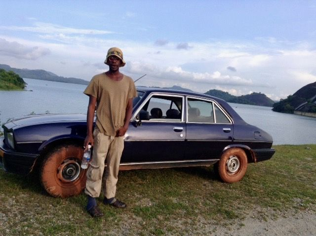 a-peugeot-504-and-a-man