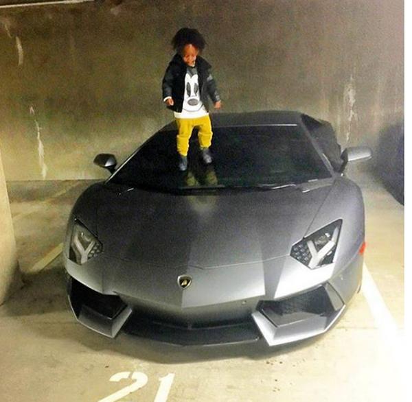 Obafemi-Martins'-son-stepping-on-his-Lamborghini-Aventador