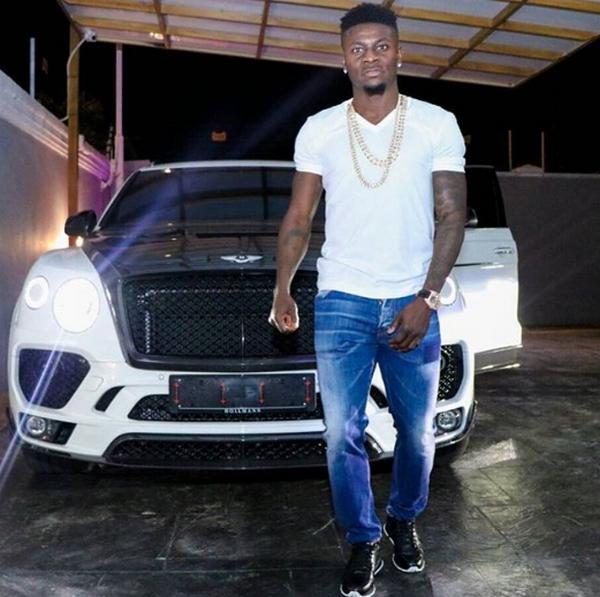 Obafemi-Martins-and-his-Bentley-Bentayga