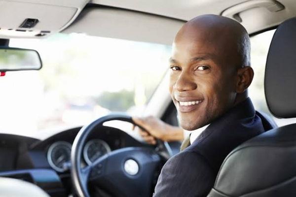 Black-man-in-a-car-looks-back
