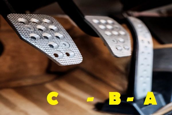 Clutch-brake-and-accelerator-pedals-with-a-label