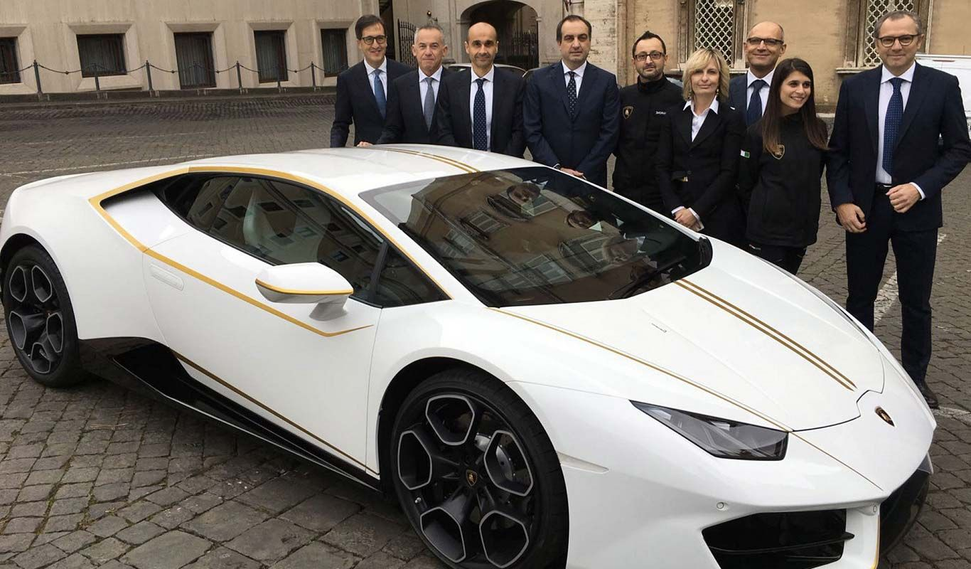 a-white-lamborghini-and-some-people