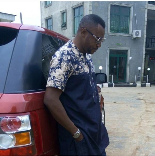 Odunlade Adekola-leaning-against-his-Range-Rover