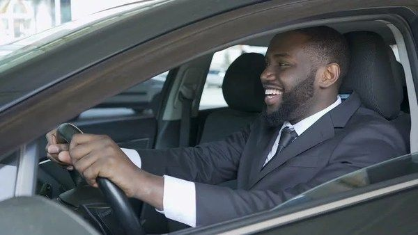 A-black-man-drives-a-car