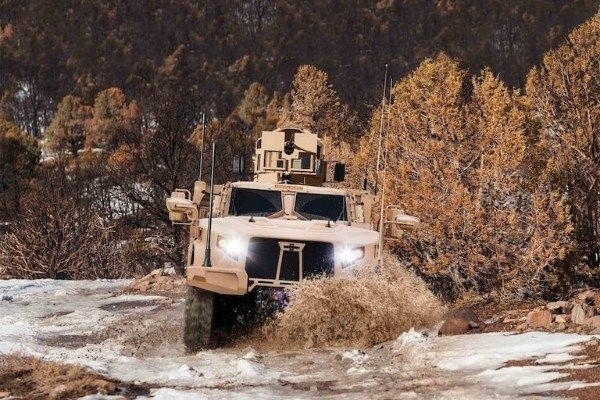 A-JLTV-trudging-through-the-woods-and-snow