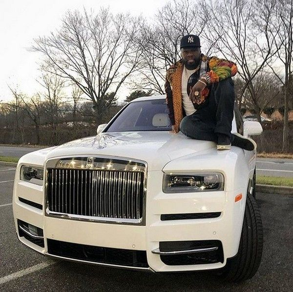 50-Cent-sitting-on-the-hood-of-his-white-Rolls-Royce