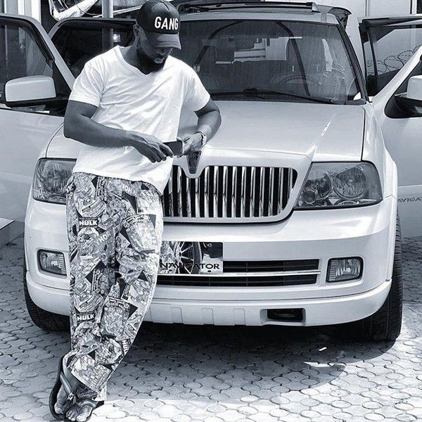 Yomi-Casual-poses-with-his-new-white-Lincoln-Navigator