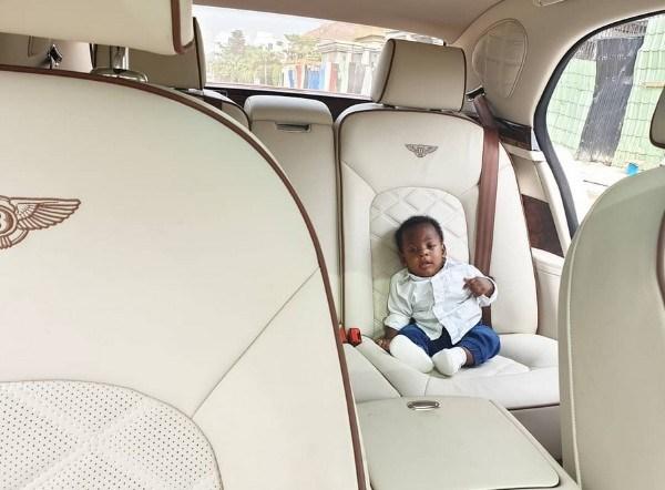 Landa's-baby-sits-on-car