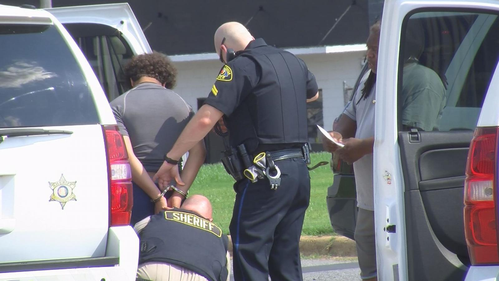 2-police-officers-arrest-a-black-guy
