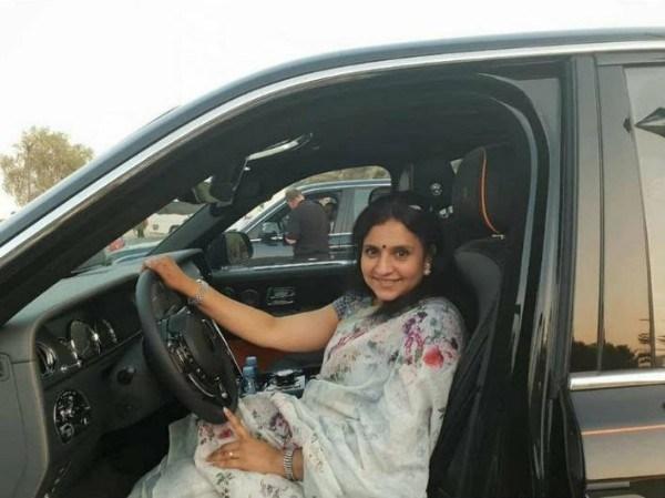 a-woman-sitting-on-car