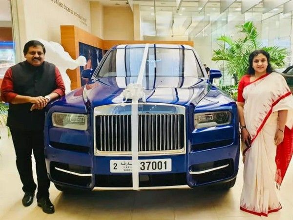 a-couple-standing-beside-a-Rolls-Royce-Cullinan