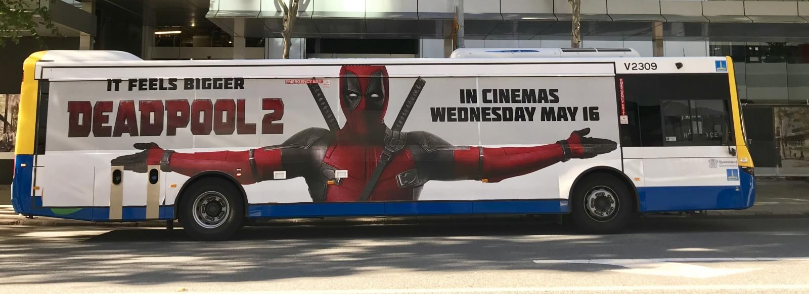 a-coach-with-deadpool-poster-on