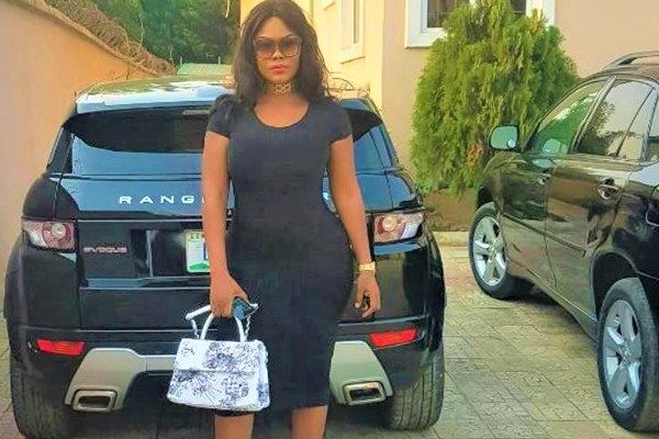 Okeke-beside-her-car