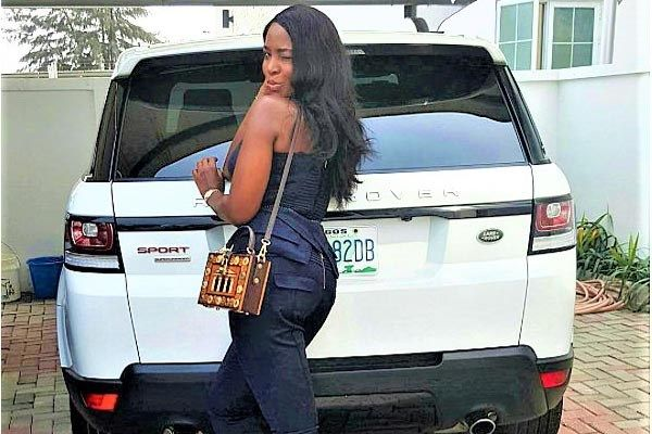 Linda-Ikeji-and-her-land-rover-sport
