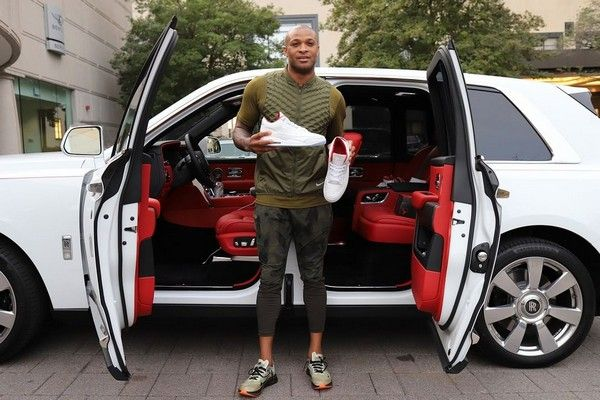 P.J.Tucker-holding a-pair-of-sneakers