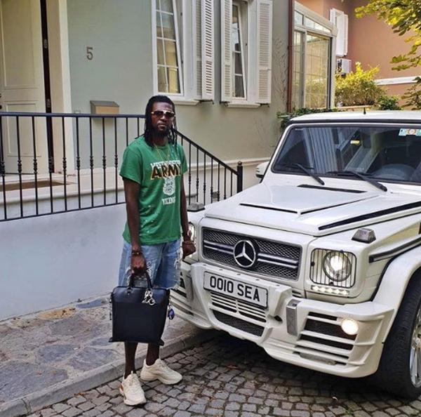 Emmanuel-Adebayor-and-white-car