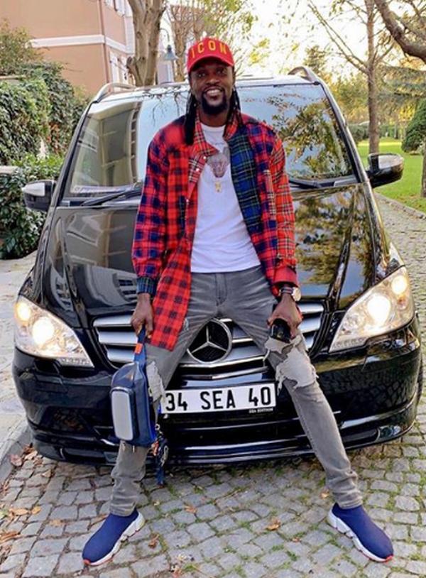 Emmanuel-Adebayor-on-hood