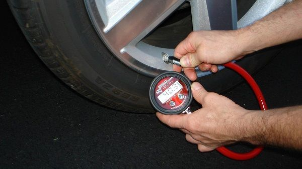 image-of-a-man-checking-tyre-pressure