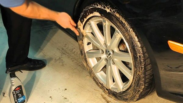 image-of-a-man-washing-tyre