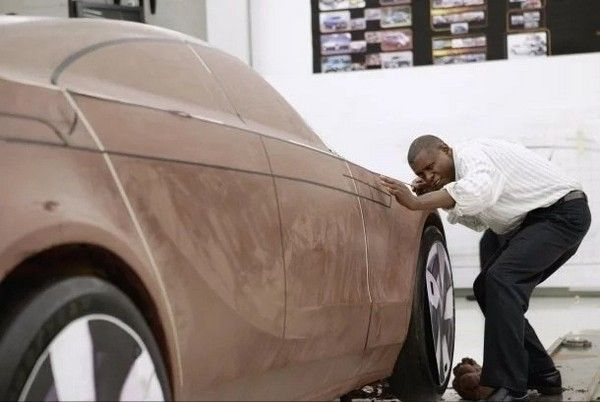 Jelani-and-a-brown-car