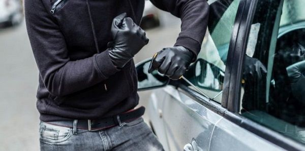 image-of-a-man-trying-to-burgle-a-car