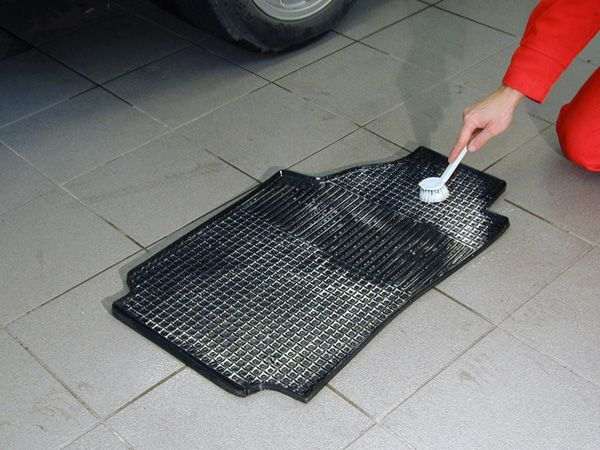 image-of-man-washing-floor-mat