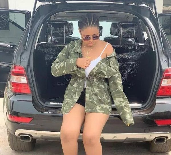 Image-of-Regina-Daniels-dancing-with-new-Benz-ML350