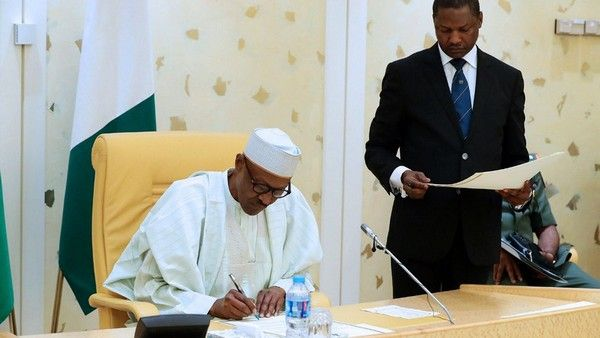 President-Buhari-signing-document