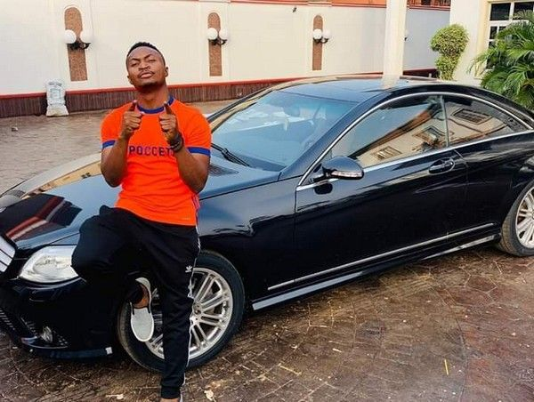 Funny-Bone-and-a-black-Mercedes-car