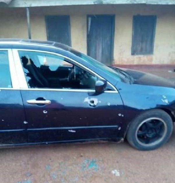 Maxwell-Etta's-bullet-bathed-car-with-a-totally-destroyed-right-door-glass