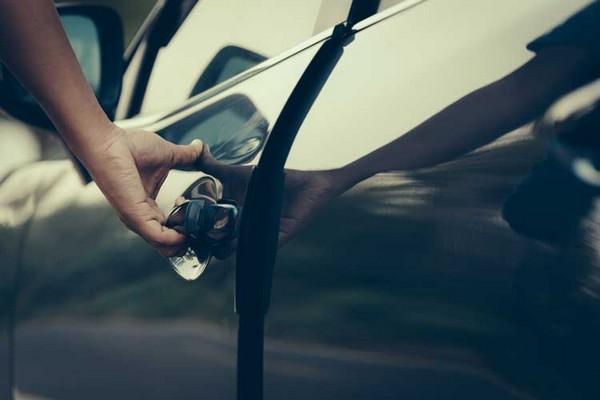 a-hand-opens-a-car-door