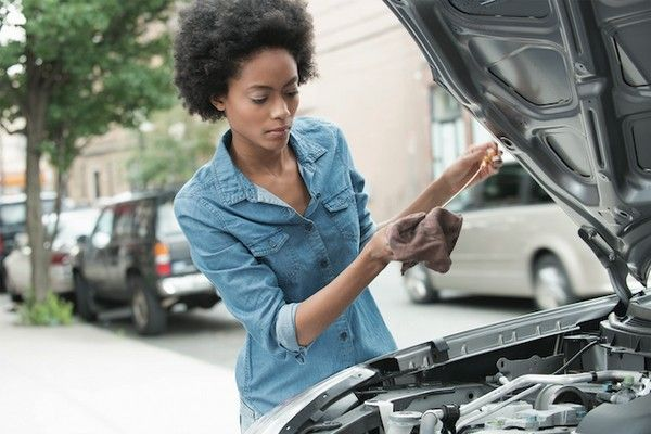 black-woman-besides-a-car