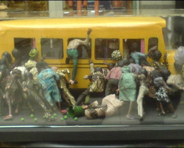 people-rushing-onto-bus-in-Nigeria