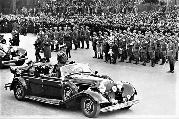 Adolf-Hitler-standing-in-Mercedes-Benz-770K-Grosser
