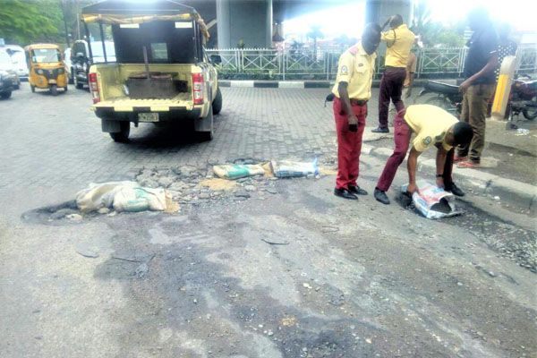 LASTMA-officials-fix-road