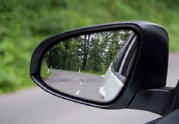 a-left-side-mirror-of-a-car