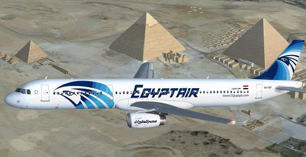 an-egypt-air-plane-flying-over-pyramids