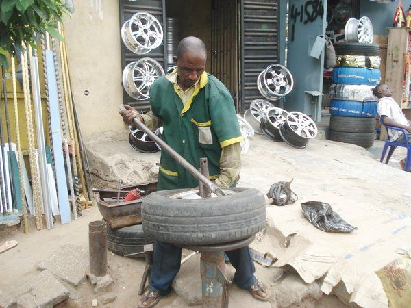 Vulcanizer-working-in-front-of-shop