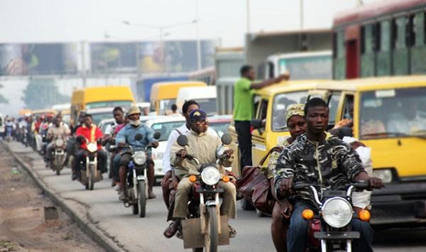 okadas-carrying-passengers-in-traffic