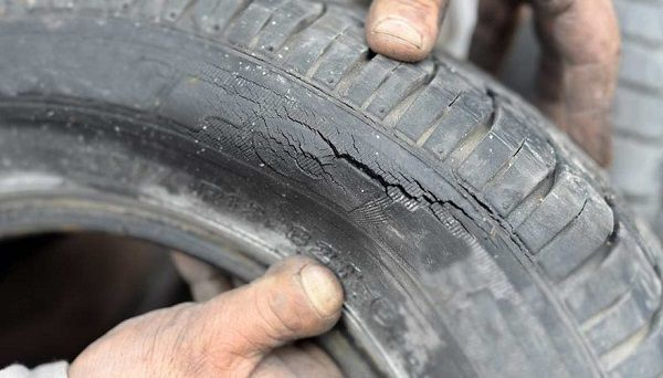 Dry-rot-being-shown-on-a-car-tire
