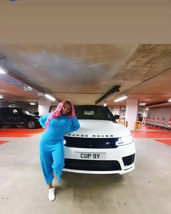 DJ-cuppy-posing-by-her-white-range-rover