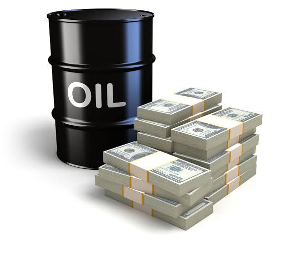 Oil tank and dollar bills