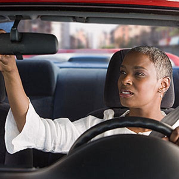 Woman-checks-rear-mirror