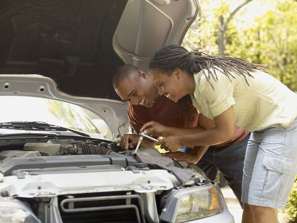 man-and-woman-fix-car