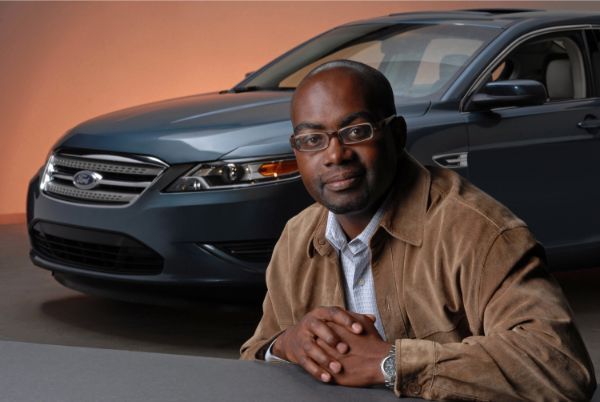 black-man-in-front-of-a-car