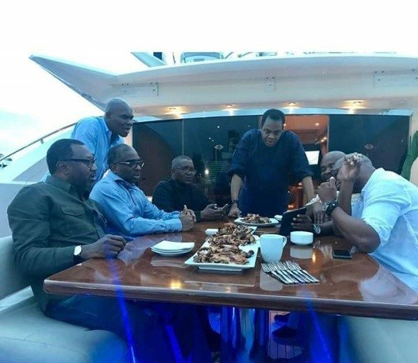 Men-around-table-on-yacht