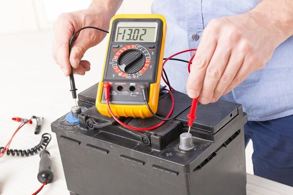 image-of-man-testing-battery-voltage