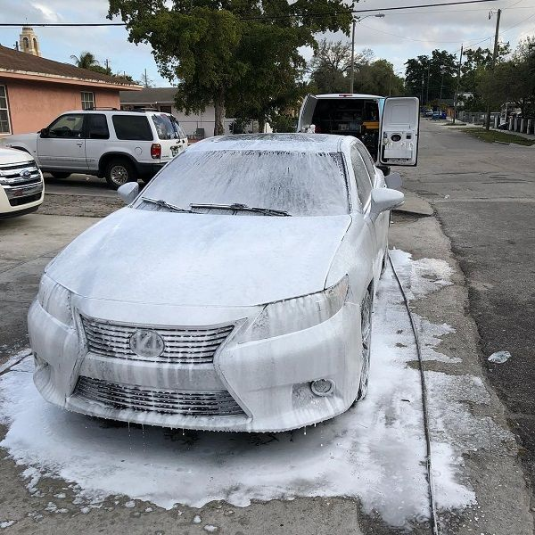 a-lexus-car-with-soap-lather-while-cleaning